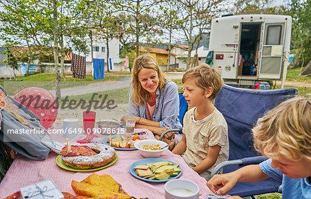 Family at picnic table celebrating boys birthday, Florianopolis, Santa Catarina, Brazil, South America