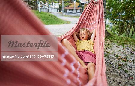 Boy lying in hammock, Tavares, Rio Grande do Sul, Brazil, South America
