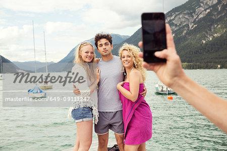 Friends posing for photograph, Innsbruck, Tirol, Austria, Europe