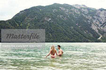 Couple waist deep in water, Achensee, Innsbruck, Tirol, Austria, Europe