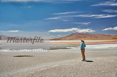 Woman standing, looking at view, Laguna Colorada, Colorada, Potosi, Bolivia, South America