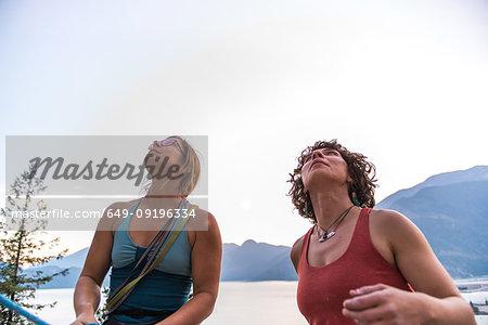 Girlfriends preparing for rock climbing, Malamute, Squamish, Canada