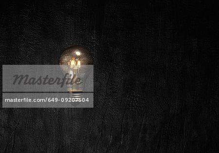 Lightbulb against black background