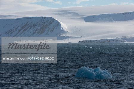 Snow covered coastal landscape and arctic ocean, Hinlopen Strait, between Nordaustlandet and Spitsbergen, Svalbard, Norway