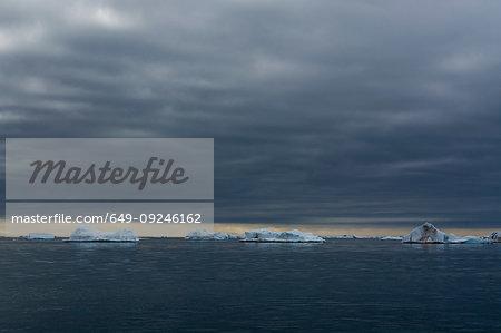 Icebergs under cloudy sky, Vibebukta, Austfonna, Nordaustlandet, Svalbard, Norway