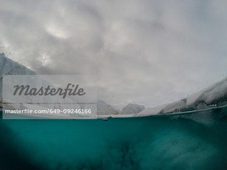 Iceberg formations, over and underwater view, Vibebukta, Austfonna, Nordaustlandet, Svalbard, Norway