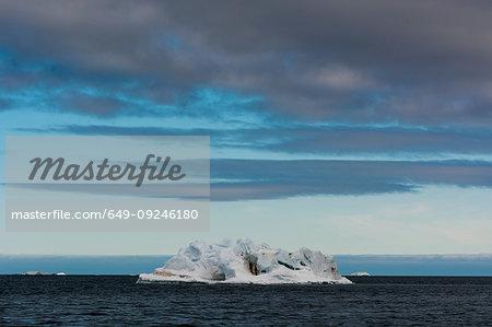 Arctic seascape with rugged iceberg,  Vibebukta, Austfonna, Nordaustlandet, Svalbard, Norway