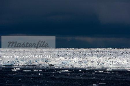 Sunlit ice floe seascape, Erik Eriksenstretet strait separating Kong Karls Land from Nordaustlandet, Svalbard Islands, Norway
