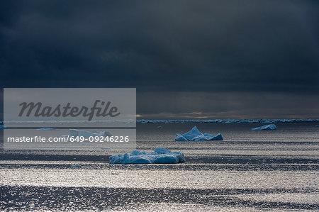 Ice floe seascape under storm clouds, Erik Eriksenstretet strait separating Kong Karls Land from Nordaustlandet, Svalbard Islands, Norway