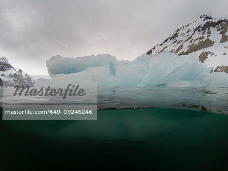Under and over view of arctic ocean and iceberg, Burgerbukta, Spitsbergen, Svalbard, Norway