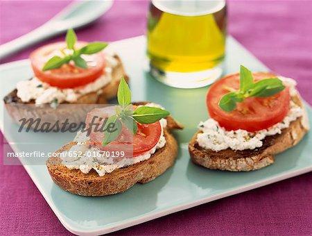 goat's cheese, tomato and basil crostini