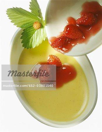 Vanilla cream dessert with wild strawberries