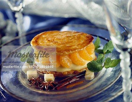 Crunchy mandarin dessert with exotic syrup