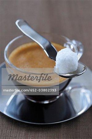 Cup of expresso a white sugar lump