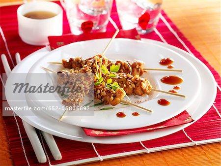 Chicken Yakitoris coated with peanuts