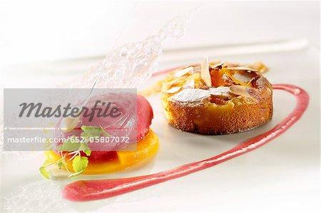 Small apple and almond Clafoutis,raspberry sorbet on sliced mango