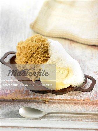 Sponge-shaped almond cake and white chocolate shaped soap