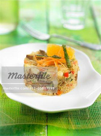 Quinoa, mandarin, seitan, carrot and red pepper in aspic