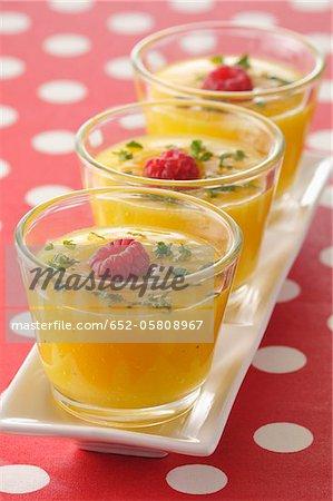 Mango soup with raspberries