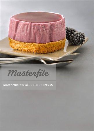 Small blackberry Bavarian on a crunchy almond base