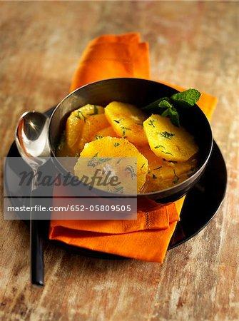 Orange fruit salad with cinnamon and mint