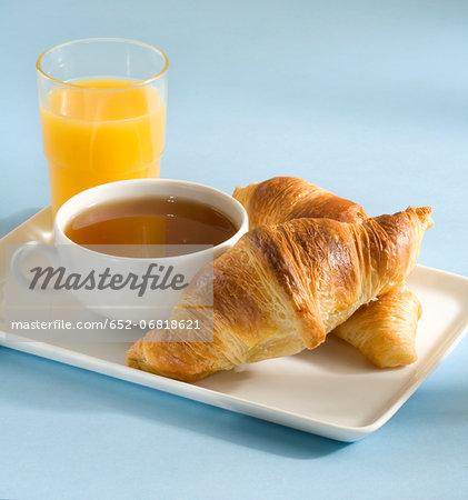 Breakfast with croissants,tea and orange juice