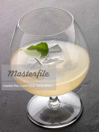 Flower power cocktail made with pear Eau-de-vie,grapefruit juice and orange blossom