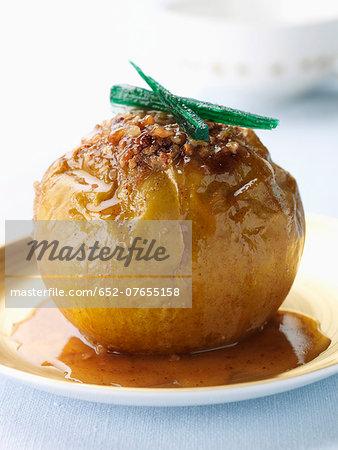 Bake apple stuffed with crushed hazelnuts,brown sugar and cinnamon