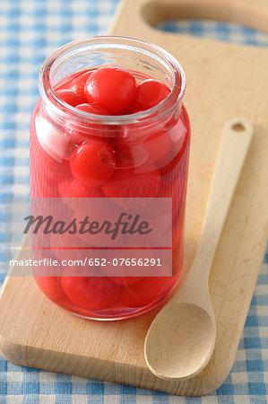 Jar of stewed cherries in syrup