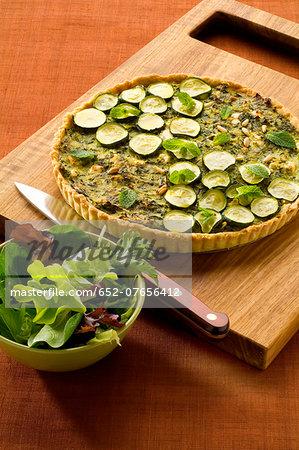 Zucchini,feta and pine nut tart