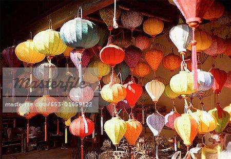 colorful paper lanterns hanging at market stall stock photo