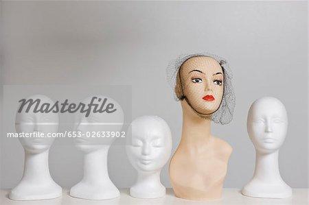 Mannequins on a shelf