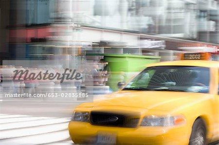 A yellow taxi on a city street, Manhattan, New York City