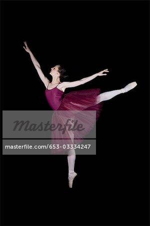 A ballet dancer doing an arabesque