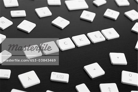 Computer keys spelling the word HACKER