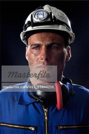 A coal miner, portrait, looking away