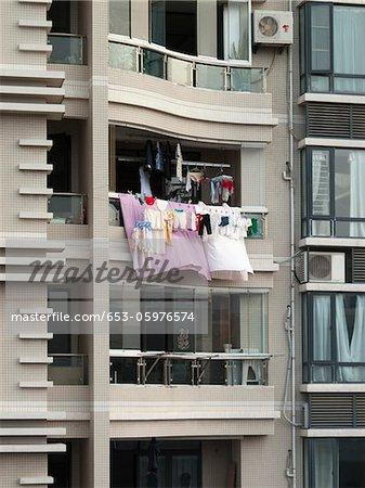 Laundry hanging from a balcony, Xiamen, China
