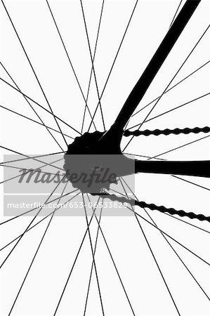 Detail of a bicycle wheel, back lit, studio shot