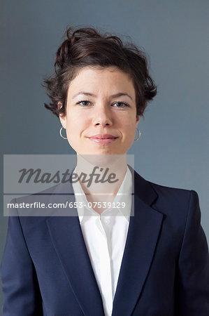 Portrait of a confident mid adult woman smiling, close-up