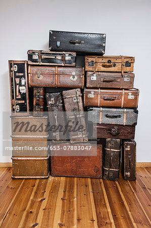 old suitcases on hardwood floor stock photo masterfile premium