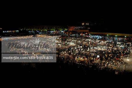 Illuminated Jamaa el Fna square at night, Marrakesh, Morocco