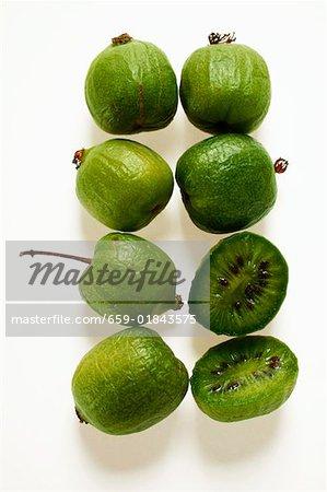 Mini-kiwi fruits, one halved