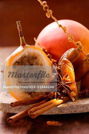 Still life with dates, star anise cinnamon, granadilla & mango