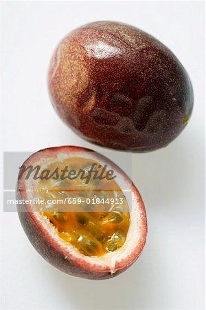 Whole and half passion fruit (Purple granadilla)
