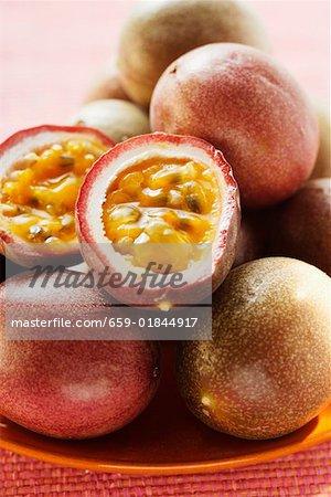 Passion fruits (Purple granadilla), one halved