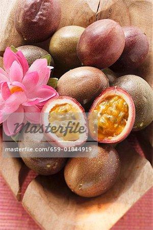 Passion fruits (Purple granadilla) in wooden bowl