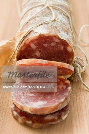 Italian salami with slices cut
