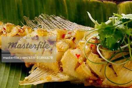 Fried zander on banana leaf (Indonesia)
