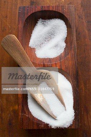 Salt in wooden bowl with scoop