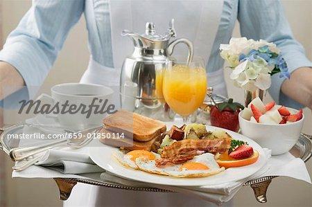 Chambermaid carrying breakfast tray